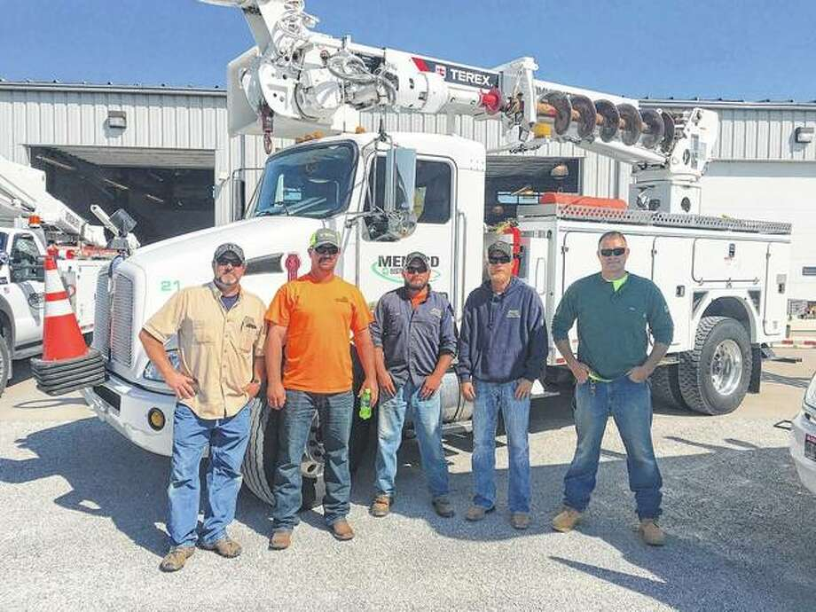 Menard Electric Cooperative linemen Robb Hanner (from left), Brandon Blair, Levi Vogt, Nick Schachtsiek and Matt Wassell arrived home after a week aiding Georgia cooperatives in restoring power to thousands after Hurricane Irma.