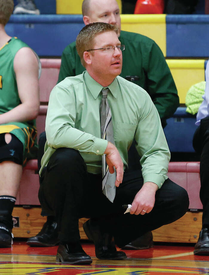 Southwestern coach Jason Darr watches his team from in front of his team's bench during a SCC game last season at Milazzo Gym in Roxana. Darr, in his seventh season as head coach at his alma mater, has the Piasa Birds off to a 7-3 start heading to the State Farm Classic next week in Bloomington. Photo: Scott Kane / For The Telegraph