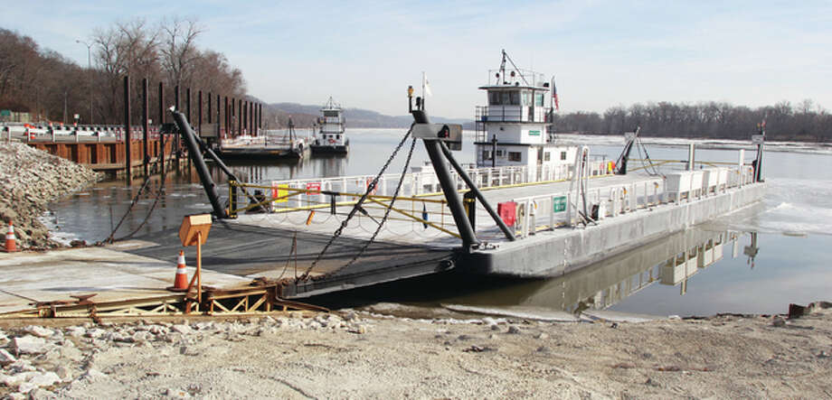 For Riverbend crews of three year-round ferries — the Brussels and Kampsville ferries, on the Illinois River, run by IDOT and Golden Eagle Ferry on the Mississippi River — the battle to keep boats crossing the river is constant as temperatures drop. Photo: Scott Cousins The Telegraph