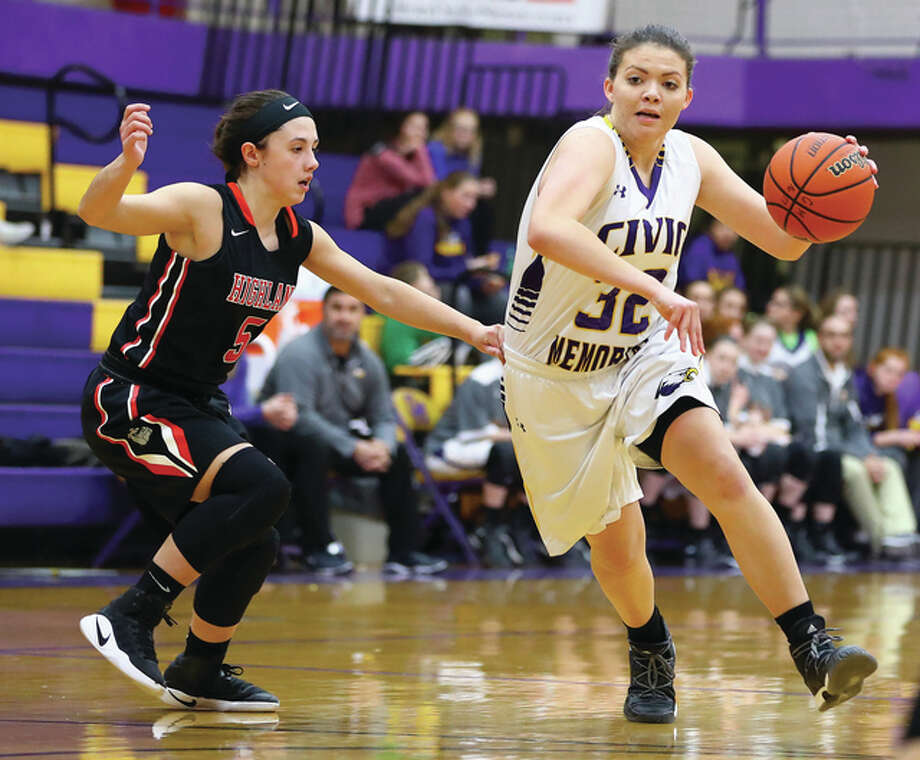 Civic Memorial's Alaira Tyus (right) drives past Highland's Ellie Brown during Tuesday night's game in Bethalto. The Eagles defeat the Bulldogs 58-53 and take an 11-0 record into this week's Jersey Tournament at Havens Gym in Jerseyville. Photo: Billy Hurst / For The Telegraph