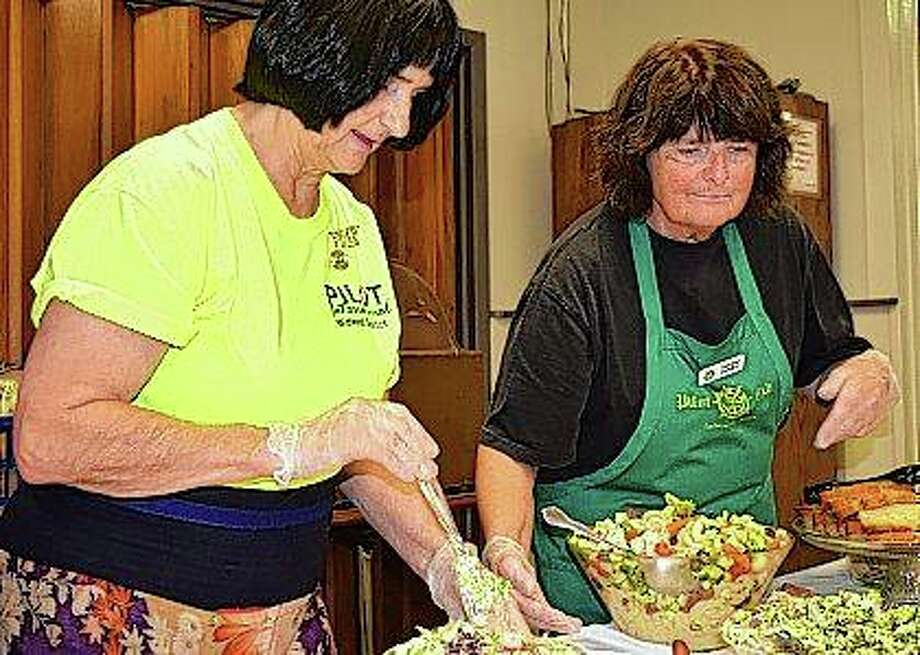 Pilot Club members Karla Henderson (left) and Delsi Clancy serve food at the club's first-ever salad luncheon fundraiser Wednesday. All of the food was made by Pilot Club members and proceeds go toward funding local programs. The club hopes to do the luncheon again next year. Photo: Nick Draper | Journal-Courier