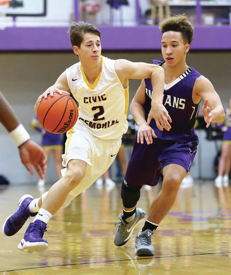 Civic Memorial's Caden Clark (left), shown driving past Mascoutah's Noah Brandon in an Eagles win Dec. 13 in Bethalto, helped CM to a pair of victories Monday on the opening day of the Freeburg Tournament. Photo: Billy Hurst / For The Telegraph