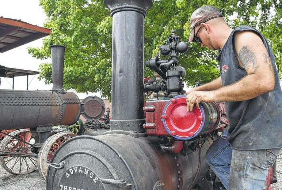 Matt Hall of Houghton, Iowa, inspects an 1892 Advance 6 horsepower steam traction engine Thursday prior to this weekend's annual Prairie Land Heritage Museum Fall Festival and Steam Show Days, which begin today in South Jacksonville. The Advance engine, which will be running this weekend, is one of only three of its type known to exist, according to Hall. Photo: Greg Olson | Journal-Courier