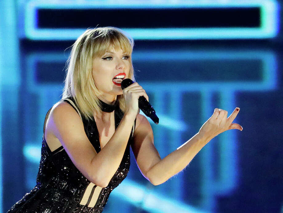 "FILE - In this Oct. 22, 2016 photo, Taylor Swift performs in Austin, Texas. Ninety-six-year-old Cyrus Porter is a devoted Taylor Swift fan and has traveled to her shows, but on Monday, Dec. 26 2016, he didn't have to go anywhere, Swift came to him. Swift had learned about the World War II combat veteran's fandom and decided to surprise him. A day after Christmas a van carrying Swift pulled into the driveway of his home in New Madrid, Mo. The singer stayed about an hour and sang ""Shake It Off"" as Porter's relatives sang along."