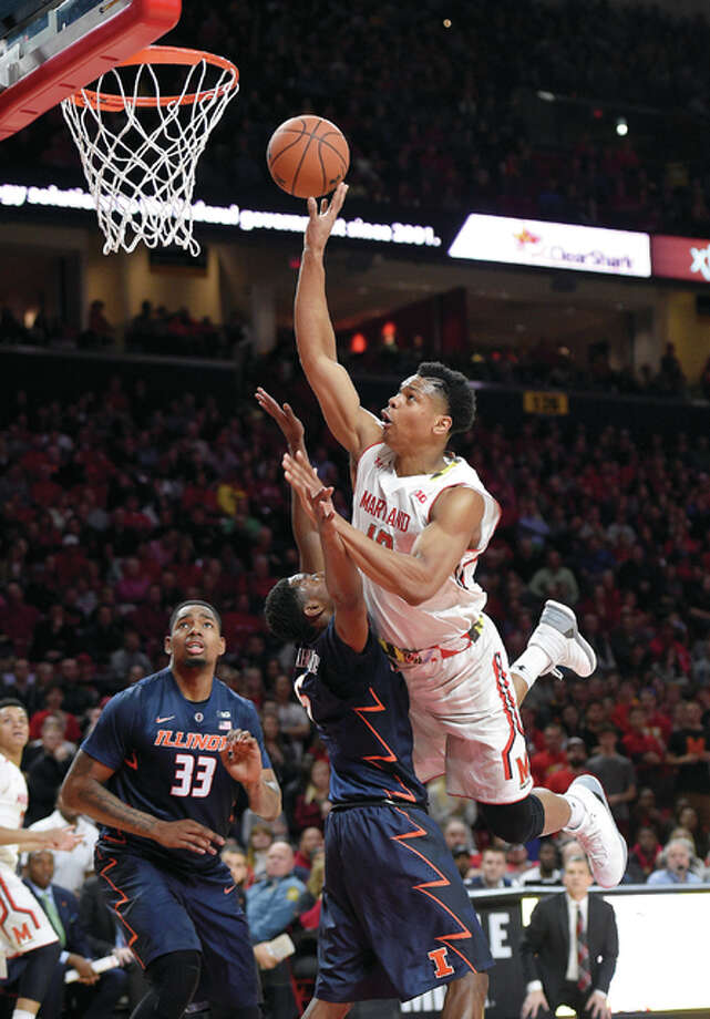 Maryland forward L.G. Gill, right, scores over Illinois guard Jalen Coleman-Lands, center Tuesday in College Park, Md. At left is Illinois center Mike Thorne Jr. (33). Maryland won 84-59. Photo: AP
