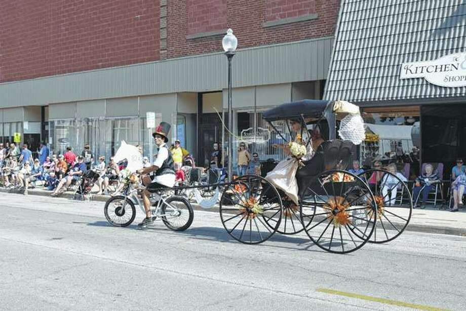 The Old Homestead Event Barn outside Beardstown entered this bicycle-powered buggy in Saturday's Beardstown Fall Fun Festival parade. Photo: Greg Olson | Journal-Courier