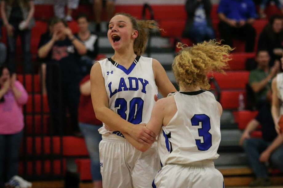 New Caney's Skylar Patton (3) and Abigail Lynch (30) celebrate after winning the girls basketball game against Dayton on Friday, Feb. 9, 2018, at Hargrave High School. (Michael Minasi / Houston Chronicle) Photo: Michael Minasi, Staff Photographer / © 2017 Houston Chronicle