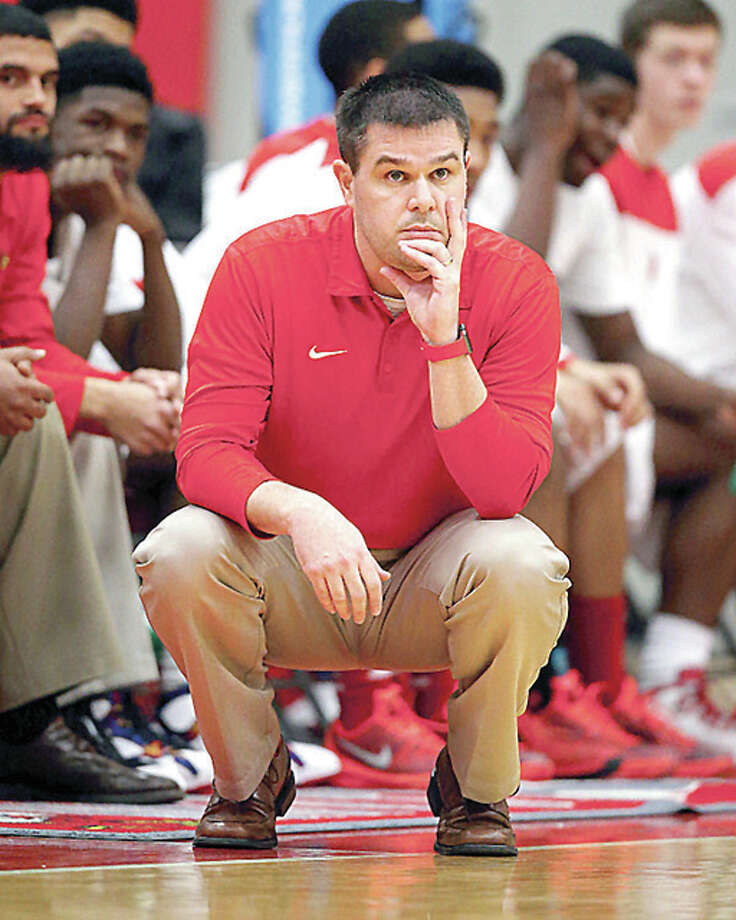 Alton Redbirds head coach Eric Smith's team dropped an 85-79 decision to top-seeded Champaign Central Thursday in the quarterfinals of the Centralia Holiday Basketball Tournament. Photo: Telegraph File Photo