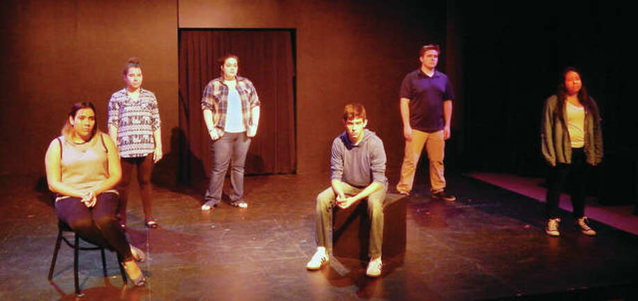 """Cast members from """"The Hidden Project: Dreamers' Stories"""" rehearse a scene Tuesday evening at the IceBox theater inside Illinois College's Kirby Learning Center. The student-written and -directed play about undocumented immigrants will be presented Friday and Saturday evening at the theater."""