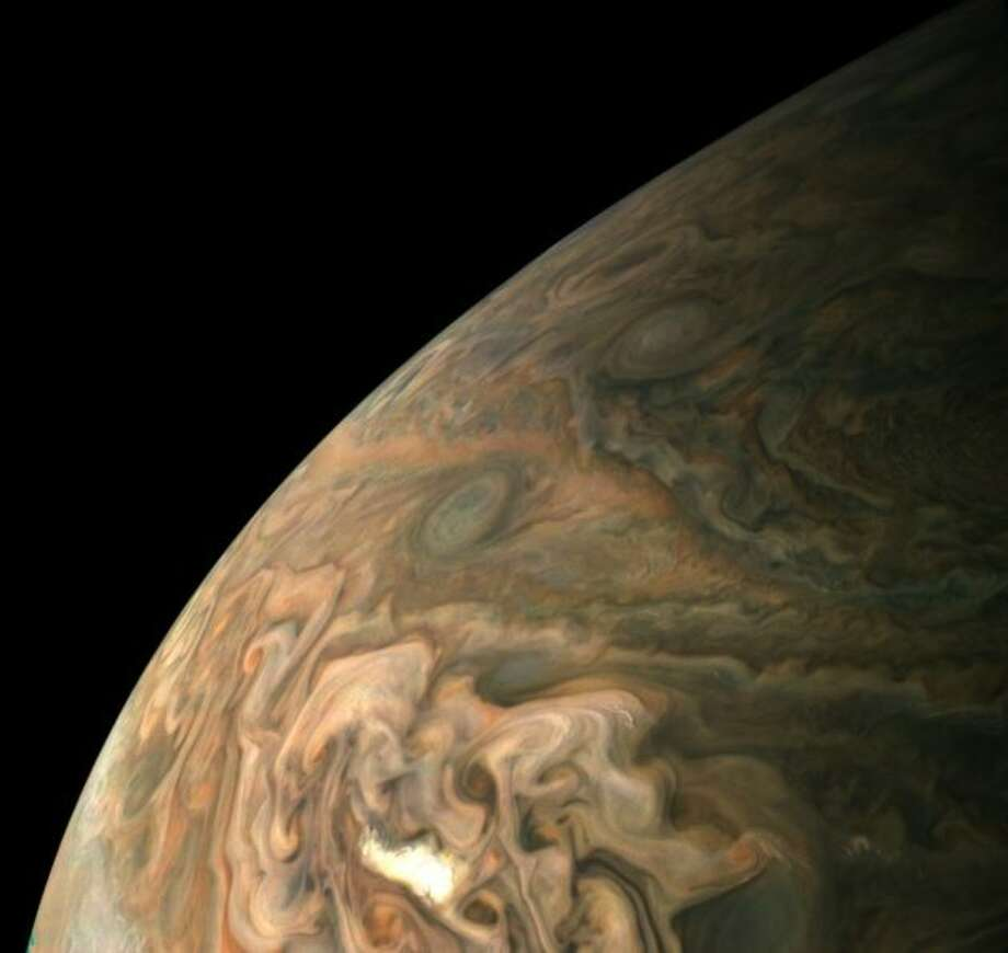 NASA's Juno probe captured this picture of Jupiter's swirling storms during a close pass on Feb. 7. (NASA / JPL / SwRI / MSSS / Gerald Eichstadt Photo)
