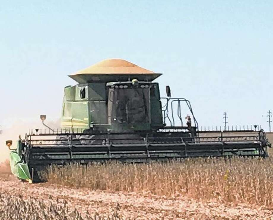 A farmer harvests a field of soybeans. Photo: Joy Harris | Reader Photo