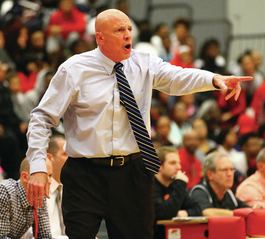 Edwardsville coach Mike Waldo, shown during a game last season at Alton High, took his Tigers to the Collinsville Holiday Classic for the first time since 1995 and Edwardsville won its first Classic title since 1992 to improve to 11-1. Photo: Billy Hurst / Telegraph File Photo