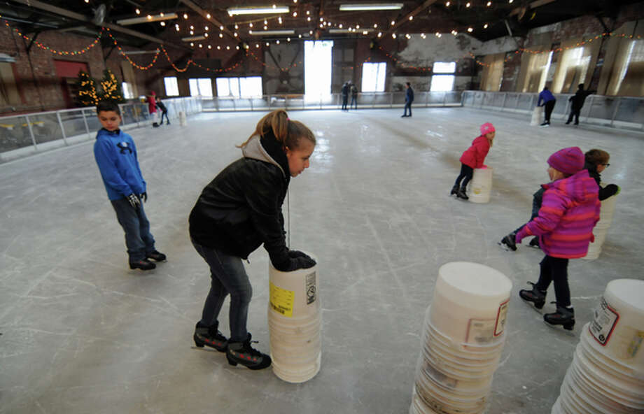 Ten-year-old Elizabeth Hill of Nokomis steadies herself while ice skating for the first time at the Loading Dock in Grafton.