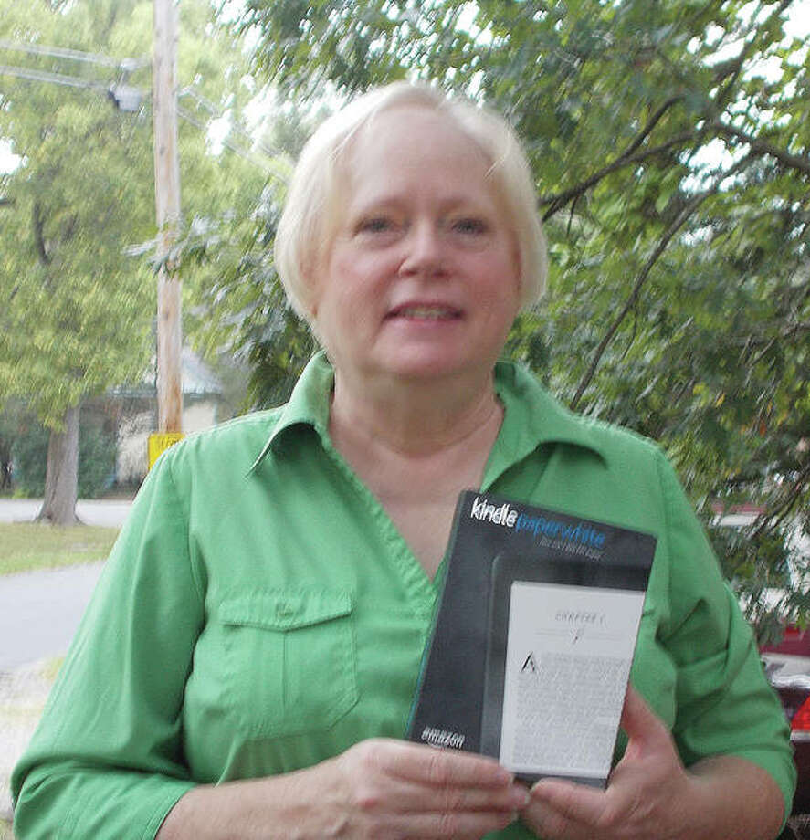 Sally Strohbeck of Carlinville holds the Kindle Paperwhite e-reader she won in a drawing as part of Carlinville Public Library's 90th anniversary celebration. The library has been active in Carlinville since 1927. Photo: Photo Submitted