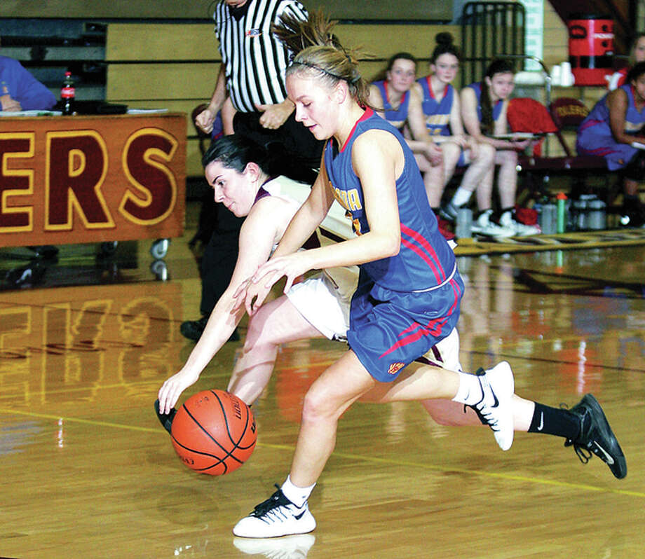 Roxana's Emma Lucas and EAWR's Carley Campbell go after a loose ball Wednesday night in Wood River. Lewis was able to scoop up the ball and take it in for a two pointer. Photo: James B. Ritter | For The Telegraph