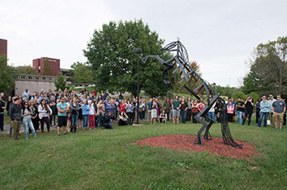 For The Telegraph A crowd gathers to view one of the pieces featured in the 2016 Sculpture Walk at SIUE. Photo: For The Telegraph