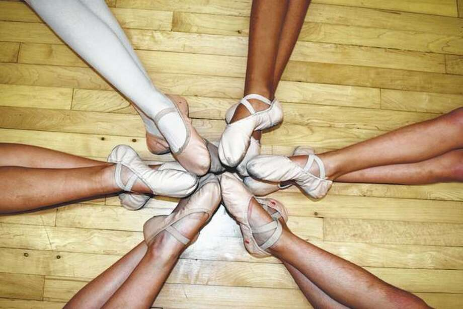 """The six Stevens dancers who will perform in """"The Great Russian Nutcracker"""" show off their ballet shoes. Photo: Greg Olson 
