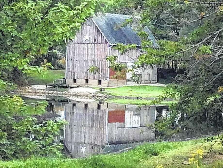 The changing fall colors paint a peaceful backdrop for an old barn and pond between Rushville and Ripley. Photo: Vonna Park | Reader Photo