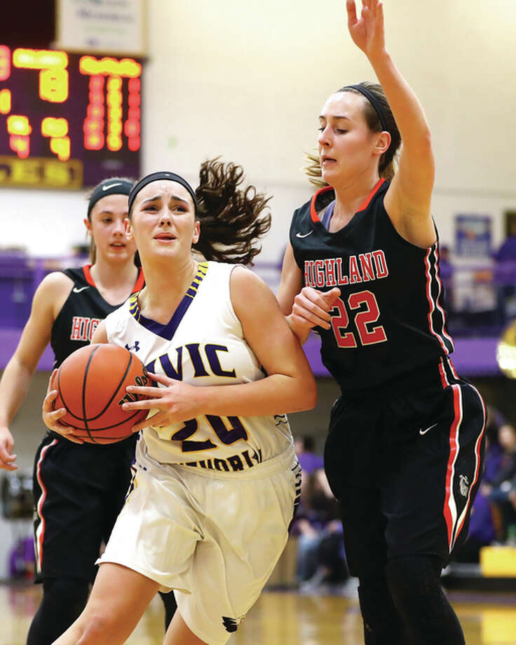 Civic Memorial freshman Anna Hall (left), shown in a Dec. 20 game with Highland in Bethalto driving to the hoop against Highland's Madison Wellen, scored a team-high 12 points Saturday morning in the Eagles' loss to the Bulldogs in Highland. Wellen scored 19 points and was named the game's Outstanding Player in the 26th annual Highland Optimists Shootout. Photo: Billy Hurst / For The Telegraph
