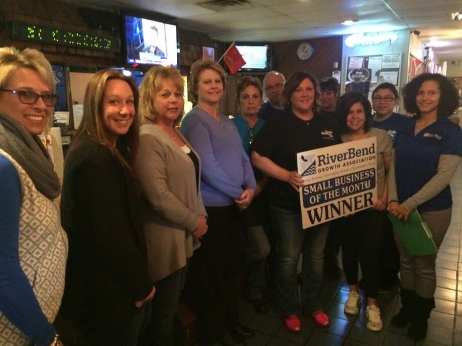 Alton Sports Tap owners Brandie Desherlia and Rick Eveans pose with members of the RiverBend Growth Association after received the RBGA's Small Business of the Month award for January.