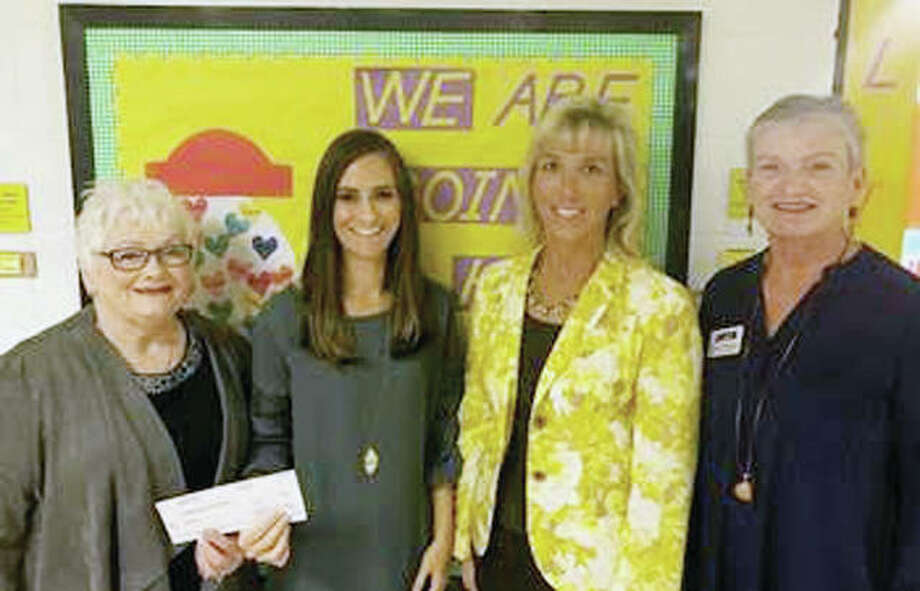 The Illinois Retired Teachers Association Foundation recently awarded $36,500 in grant money to several public school educators statewide, including Trista Barrett (second from left), a speech teacher with A-C Central Community Unit School District 262, Virginia CUSD 64 and Chandlerville Area 4. On hand for the check presentation were Sue Taylor (left), A-C Central Elementary School Principal Deborah Rogers (second from right) and IRTAF representative Donna Sargent. The grant funds will be used to help diagnose and treat communication impairments that hinder academic and social success. Photo: Photo Provided