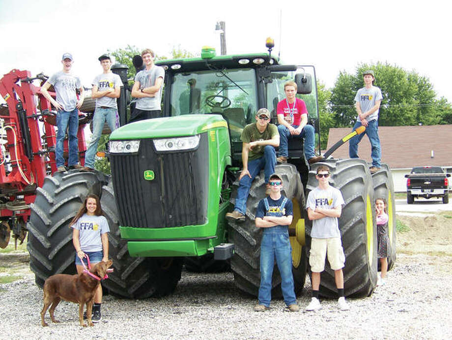 Franklin Junior-Senior High School FFA members recently celebrated Agriculture Awareness Day. Members participating were Ethan Hansell (from left), Samantha Mies, Andrew McGath, Adam Morris, Joshua Wilson, Marcus Richards, Jared Miller, Jackson Smith and Luke Bergschneider. Jay Harris, Josh Adkins, Prairieland FS and Brandt's provided farm equipment for the day's activities. Photo: Photo Submitted