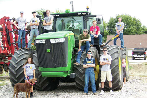 Franklin Junior-Senior High School FFA members recently celebrated Agriculture Awareness Day. Members participating were Ethan Hansell (from left), Samantha Mies, Andrew McGath, Adam Morris, Joshua Wilson, Marcus Richards, Jared Miller, Jackson Smith and Luke Bergschneider. Jay Harris, Josh Adkins, Prairieland FS and Brandt's provided farm equipment for the day's activities.