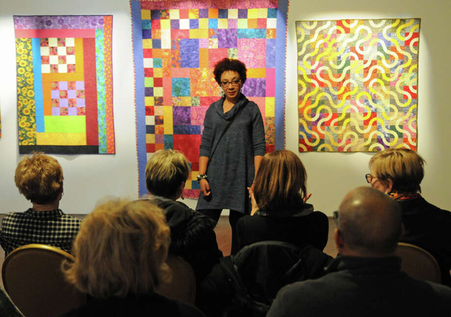 "Quilt artist Angee Turner, of St. Louis, talks to visitors during Saturday's ""Improv Quilting: African American Traditional Improvisational Design and Composition"" program at Alton's Jacoby Arts Center."