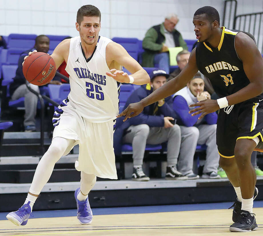 Luka Radosevic, left, scored six points for LCCC in its defeat at the hands of nationally ranked Vincennes University in LC's second-half opener. LCCC will play at John A. logan College Wednesday in Carterville. Photo: Billy Hurst File Photo | For The Telegraph