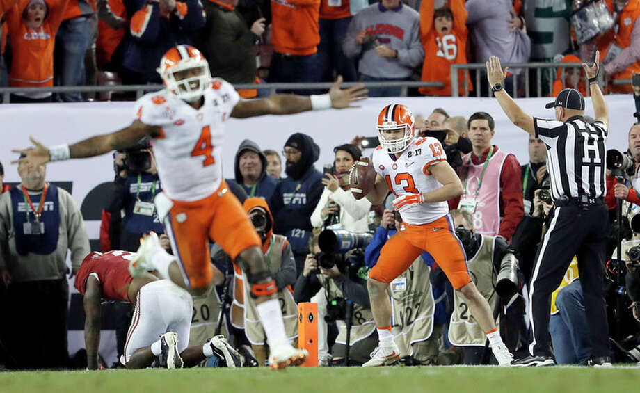 Clemson's Deshaun Watson celebrates his last-second touchdown pass to Hunter Renfrow (13) Monday night against Alabama in Tampa, Fla. Photo: John Bazemore | AP