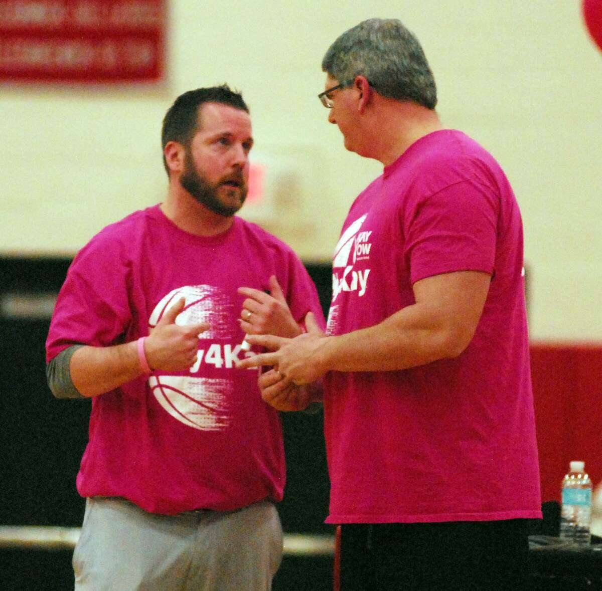Pomperaug coach Joe Fortier, left, before the Panthers' game against Newtown on Friday.