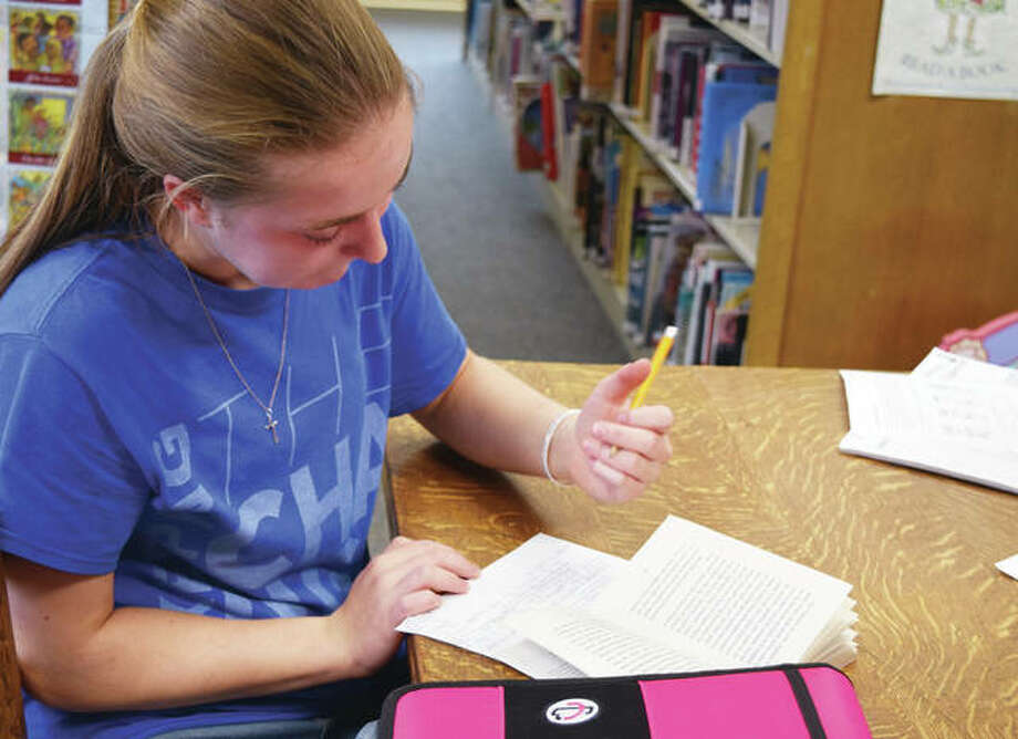 "Dalaina Gertz, a Jacksonville Middle School eighth-grader, takes notes Tuesday about the Paul Fleischman book ""The Seedfolks"" at Jacksonville Public Library. Photo: Samantha McDaniel-Ogletree 