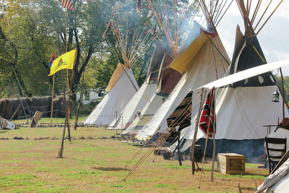 An old Gadsden flag flies in front of a row of tents at a past Old Settlers Days festival. Photo: For The Journal-Courier