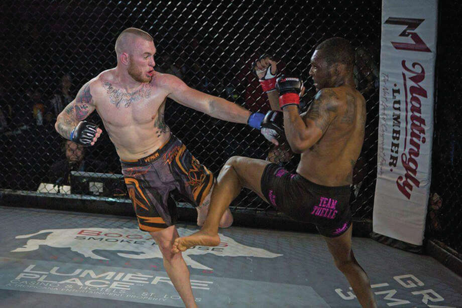 Brandon Lowe, left, an East Alton-Wood River High School graduate, in a mixed martial arts (MMA) fight last year. Lowe, 26, is determined to fight his way to the top of the MMA world despite battling illnesses. Photo: For The Telegraph