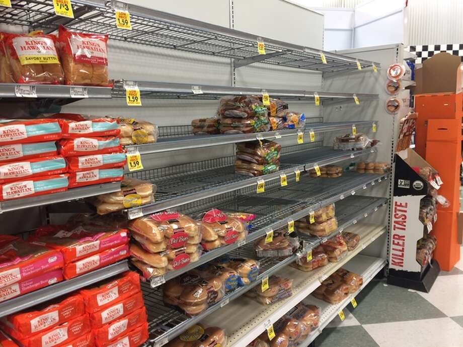 The bread aisle at Schnucks Market in Godfrey showed the effects of shoppers stocking up prior to winter weather. While many braced for the impact of the ice and freezing rain, local businesses braced for the influx of customers ahead of the storm.