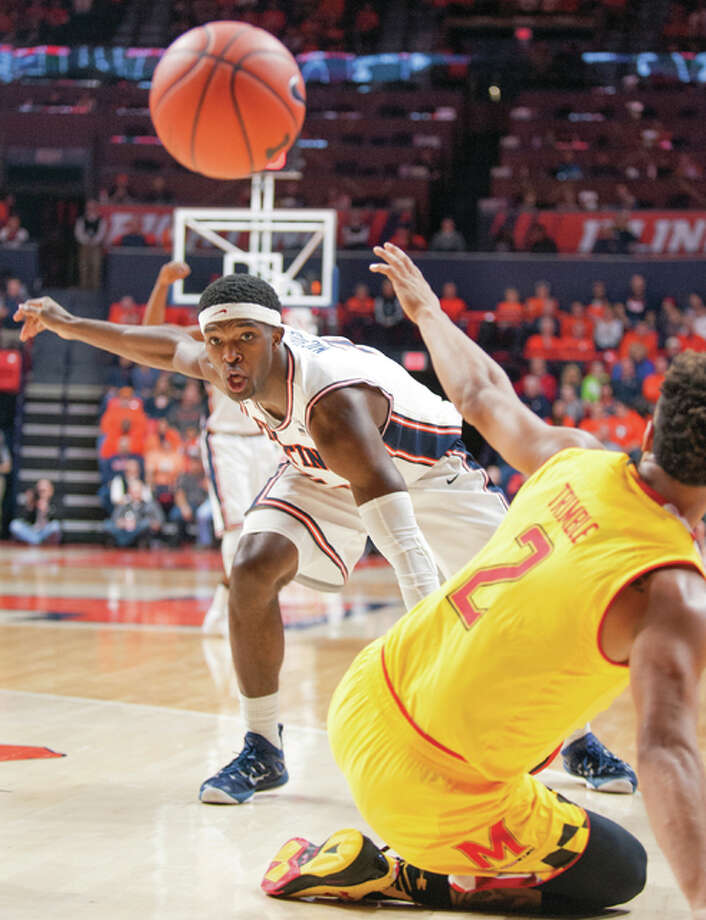 Illinois' forward Kipper Nichols (2) keeps his eye on a loose ball by Maryland's guard Melo Trimble (2) Saturday in Champaign. Photo: AP