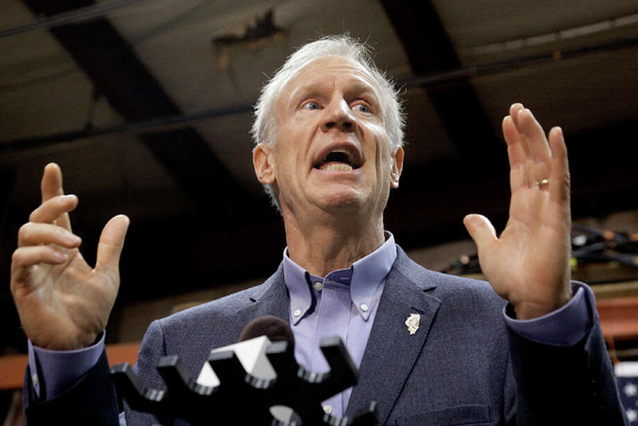 In this Nov. 16, 2016, AP file photo, Illinois Gov. Bruce Rauner speaks to reporters in Springfield, Ill. Rauner announced this week plans for a tour of schools throughout the state to connect with Illinois' best and brightest young students.