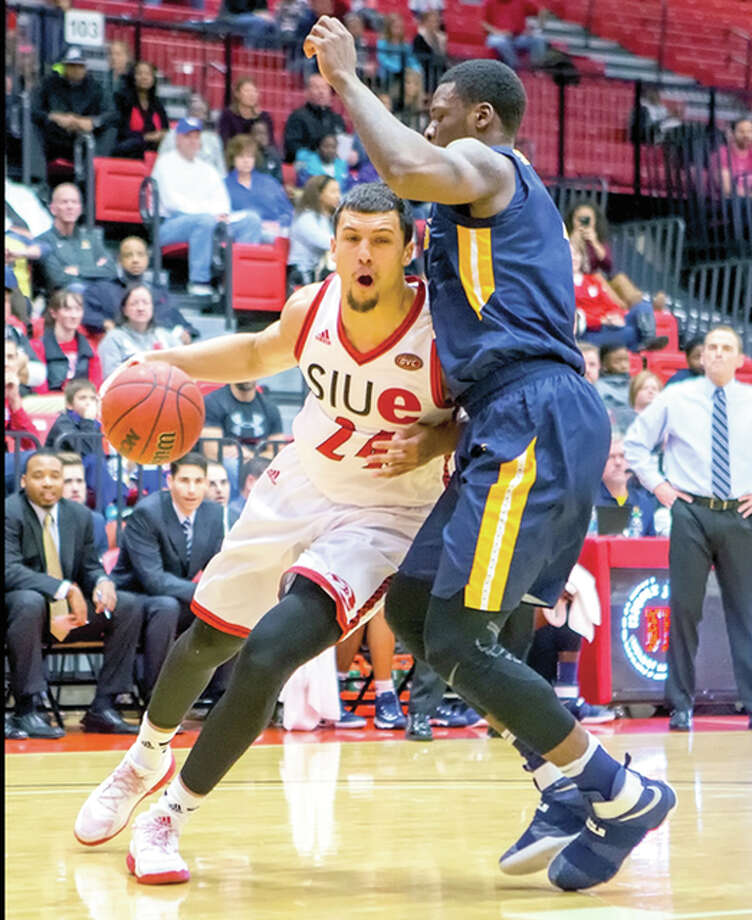 SIUE's Jalen Henry, left, drives against Murray State Saturday nigt at the Vadalabene Center. Henry, a junior from Springfield Southeast, scored four points for the Cougars in their 67-59 loss. Photo: SIUE Athletics