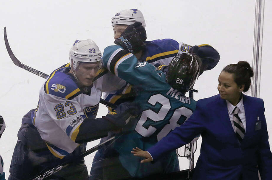 San Jose's Timo Meier (28) is pushed against the glass by the Blues' Dmitrij Jaskin (23) and Kyle Brodziak during the third period of the Blues' 4-0 win Saturday night in San Jose, Calif. Photo: Associated Press