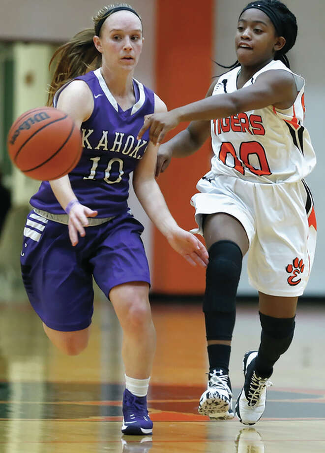 Edwardsville's Quierra Love (right) and Collinsville's Andrea Frerker go for the ball during a Tigers win Dec. 1 in Edwardsville. Love, a freshman, came off the bench to help the Tigers move to 19-0 with a victory Sunday night over Chicago Whitney Young at the St. Louis MLK Shootout at Miller Careers Academy in St. Louis. Photo: Scott Kane / For The Telegraph