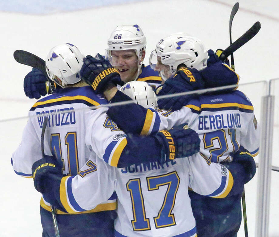 Blues players celebrate with center Patrik Berglund (right), who scored the winning goal in overtime for the 2-1 win over the Anaheim Ducks on Sunday night in Anaheim, Calif. Photo: Associated Press