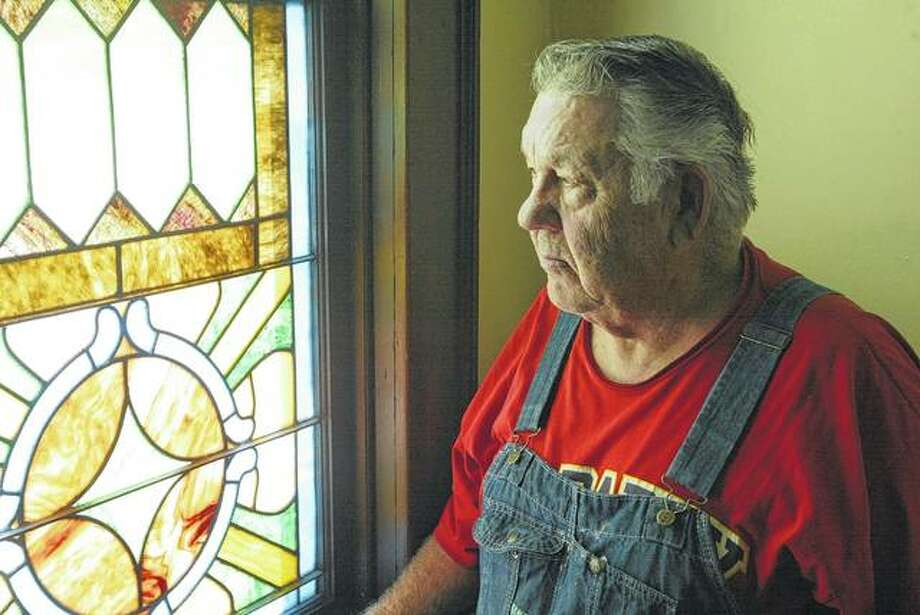 Concord Christian Church Pastor Francis Ater looks out a stained glass window at the church, which will mark its 150th anniversary Friday, Saturday and Sunday. Photo: Greg Olson | Journal-Courier