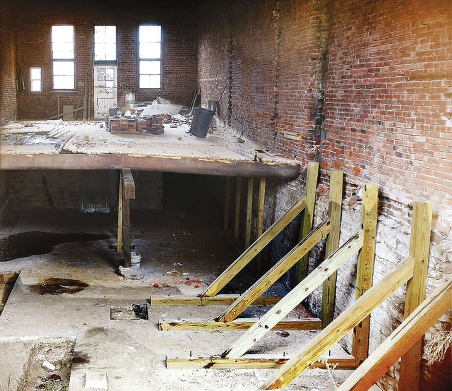A look inside the former Hudson Jewelers building, located on Belle Street next to the Hayner Public Library's downtown branch, shows a partial floor and efforts to support one wall with wooden posts. The city of Alton condemned the building last week.