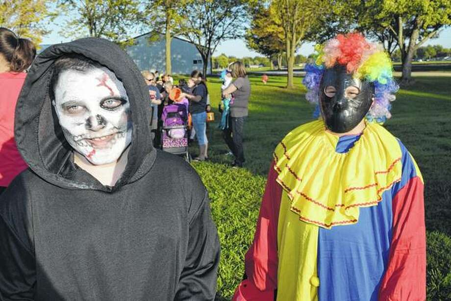 Grim reaper Jacob Thornton, the 9-year-old son of Melissa Thornton of Jacksonville, meets a scary clown, Hunter Edwards, the 11-year-old son of Sherry McVay of Jacksonville, at WJIL-WJVO's 23rd annual Safe Halloween for Kids event Thursday at Prairie Land Heritage Museum's big barn. Photo: Greg Olson | Journal-Courier