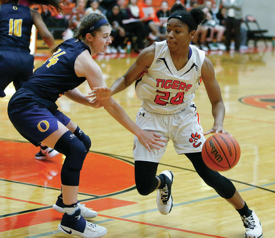 Edwardsville's Myriah Noodle-Haywood (right) drives on O'Fallon's Caitlin Kayser during a Tigers' SWC victory Jan. 5 in Edwardsville. The Tigers moved their record to 19-0 Sunday with a shootout victory in St. Louis. Photo: Scott Kane / For The Telegraph