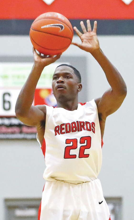 Alton's Kevin Caldwell Jr., shown shooting in a game earlier this season in Alton, and the Redbirds opened play Tuesday in the Belleville East Tournament. Photo: Billy Hurst / Telegraph File Photo