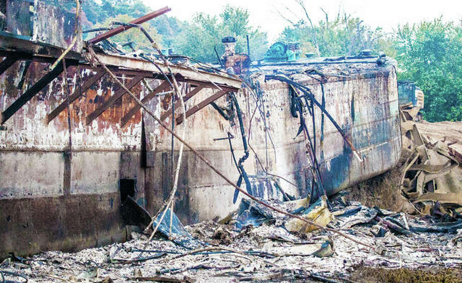 The remaining ruins of the historic, once glamorous, Goldenrod Showboat was completely destroyed by fire overnight Friday, as it remained grounded along the Illinois River just north of Kampsville. Attempts to restore the landmark had been ongoing, but were doused in May when historic flooding overtook the 108-year-old vessel. Photo: Nathan Woodside   For The Journal-Courier