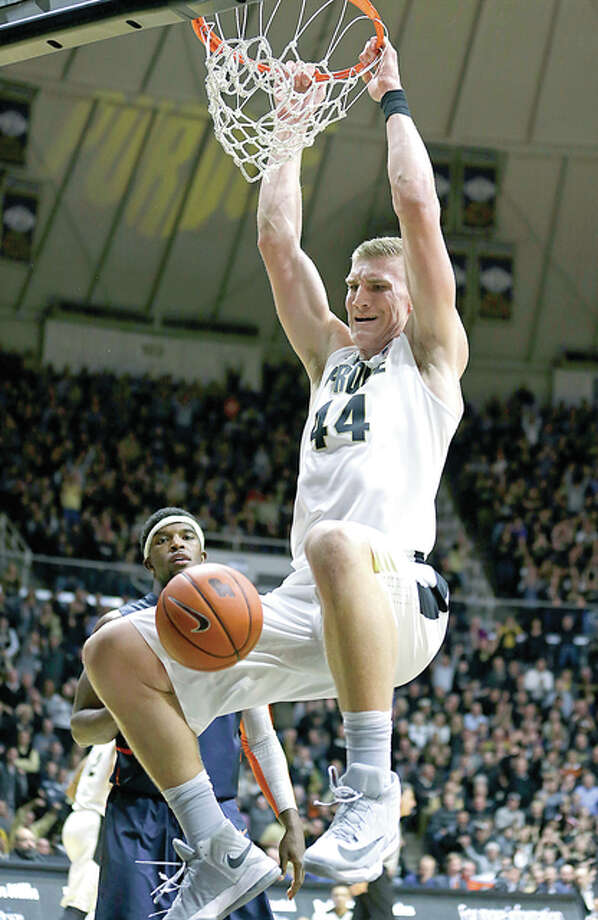 Purdue center Isaac Haas (44) dunks against Illinois Tuesday night in West Lafayette, Ind. Photo: AP