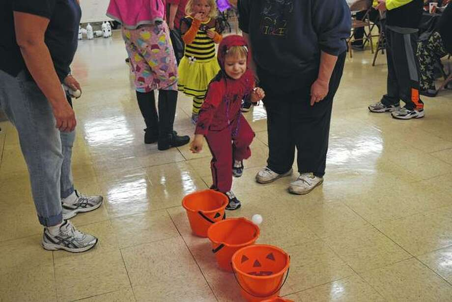 Jayce Sexten, 3, of Jacksonville plays a game Sunday during Centenary United Methodist Church's Trunk or Treat Fall Festival.