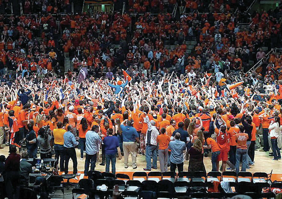 Illini fans rush the court following the team's 2013 upset of then-No. 1-ranked Indiana at Assembly Hall, now known as State Farm Center. Photo: File Photo